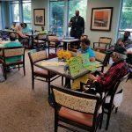 Reggie playing BINGO with senior citizens in Ward 5